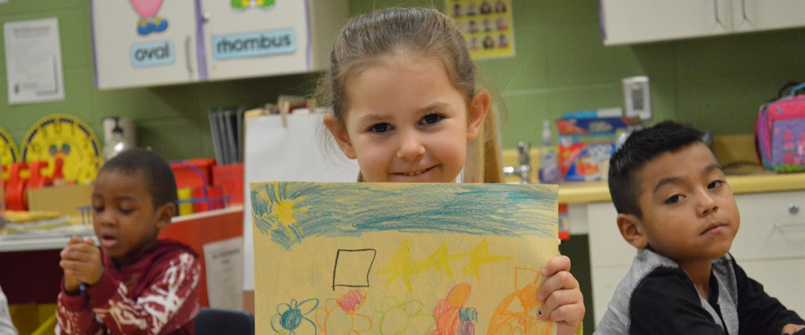 PK Student showing off drawing